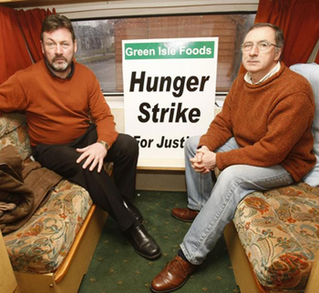 Former All-Ireland footballer John Guinan (left) joins fellow sacked worker Jim Wyse on hunger strike outside the Green Isle Foods plant in Naas, Co Kildare. Photo: PA