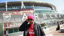 An Arsenal fan leaves the shop of Arsenal Football Club's Emirates Stadium on April 11, 2011 in London. Stan Kroenke, the owner of National Football League and the National Basketball Association teams, agreed to boost his stake in Arsenal to 63pc, triggering a takeover bid for the English Premier League team. Photo: Getty Images