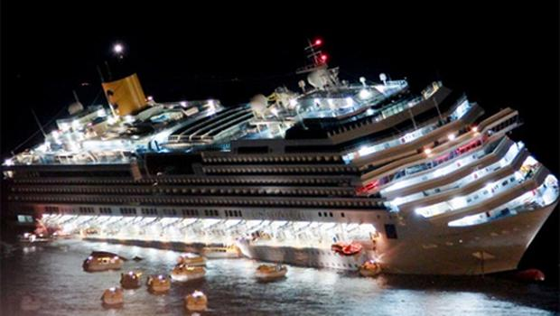 The Costa Concordia lays on its starboard side after it ran aground off Giglio island. Photo: AP