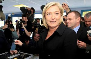 Marine Le Pen, National Front Party Candidate for the 2012 French presidential election casts her ballot to vote in the first round of the 2012 French presidential election. Photo: Reuters