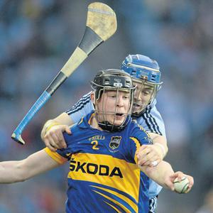Despite losing his hurl, Dublin's Niall McMorrow gets to grips with Donagh Maher of Tipperary on Saturday night in Croke Park
