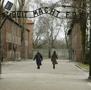 The sign at Auschwitz has been welded back together after thieves took it down