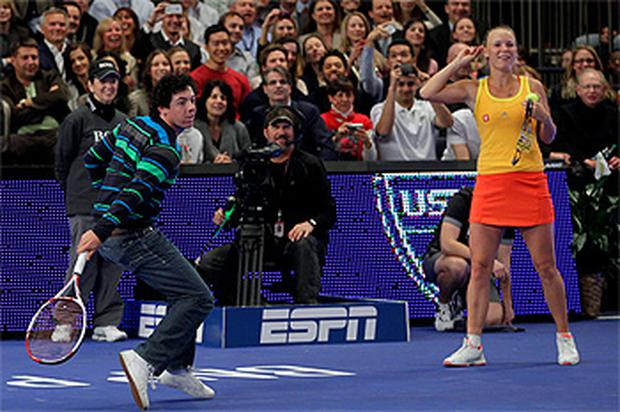 Rory McIlroy joins his girlfriend Caroline Wozniacki on the court against Maria Sharapova at Madison Square Garden in New York