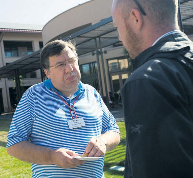 Brian Cowen talks to reporter Eoin Reynolds during a lunch break at the university. Photo: MICHAEL SHORT