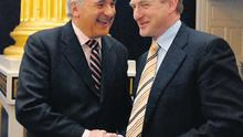 Bertie Ahern and Enda Kenny meeting at Dublin Castle yesterday at a Lisbon Treaty conference