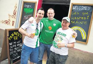 Ruaidhri Cullen from Sligo, John Doocey from Mayo, and John Brennan from Dublin outside Tanners bar in Poznan yesterday. Photo: Mark Condren