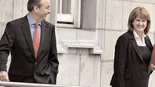 Fianna Fail leadership contender Micheal Martin jokes with Labour's Joan Burton at Leinster House yesterday