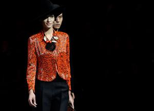 Models present creations for the Giorgio Armani fashion show in Beijing, May 31, 2012. REUTERS/Jason Lee (CHINA - Tags: FASHION)