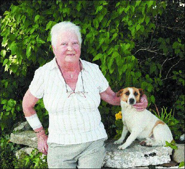 Vera Dwyer pictured Monday evening last at her home with her dog, Rusty. Pic.: Carl Brennan.