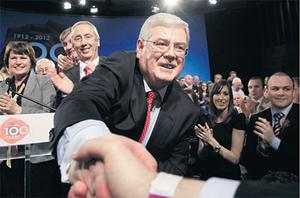 Tanaiste Eamon Gilmore is congratulated after his keynote address to the Labour Centenary Conference at NUI Galway on Saturday