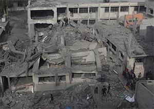Palestinians inspect a destroyed mosque after an Israeli air strike in Bureij in the central Gaza Strip