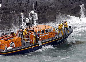 The crew of the Baltimore lifeboat retrieving bales of cocaine from the sea