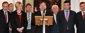 Taoiseach Brian Cowen, flanked by his frontbench colleagues, delivers a statement at Government Buildings where he insisted he will carry on until the Budget and then call a New Year election