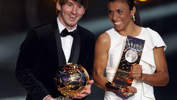 Lionel Messi and Marta hold their FIFA Ballon d'Or trophies during last night's ceremony in Zurich. Photo: Getty Images