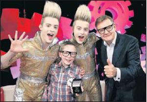 Cian Burns with Jedward and RTE news anchor, Bryan Dobson.