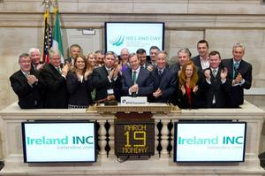 FOR WHOM THE BELL TOLLS: Taoiseach Enda Kenny ringing the opening bell at the New York Stock Exchange last Monday as part of his St Patrick's festival trip to the States, an event sponsored by Irelandinc.com. Businessman Denis O'Brien, third from left, was also in attendance