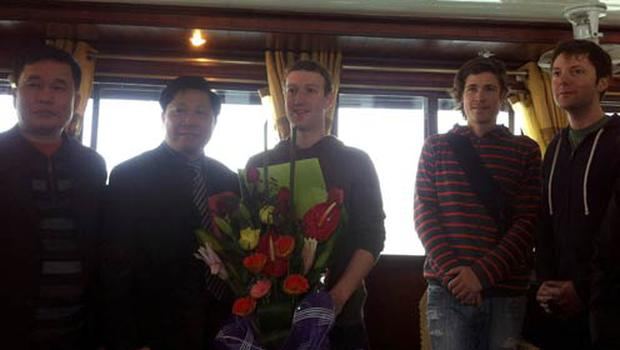 Facebook's founder and billionaire Mark Zuckerberg being greeted with flowers by two  tourist officials aboad a tourist boat before he and his girlfriend Priscilla Chan tour Ha Long Bay.