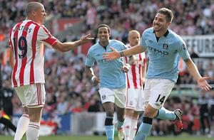 Stoke's Jon Walters is left remonstrating with his team-mates as Manchester City's Javi Garcia celebrates scoring the equaliser on Saturday