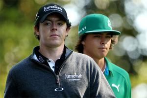 Rory McIlroy and Rickie Fowler wait on the third tee at Augusta National yesterday - the pair shot seven under and two under par respectively during the first round of The Masters