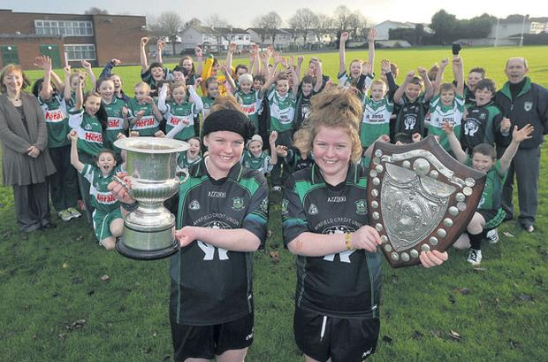 Twins Saibh, left, and Enya Hannigan with their two Cumann na mBunscoil trophies.