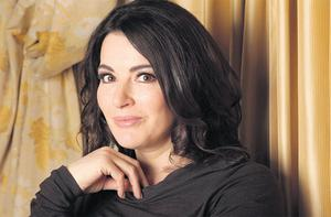 DARK DAYS: Nigella Lawson proves she can have her cake and eat it, despite 'having periods of great gloom — [but] not in a manic depressive way'. Photo: Gerry Mooney