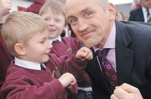 Just champion: Former WBA champ Barry McGuigan 'spars' with a you fan at the opening of Rowandale Primary, Moira, Co Antrim, in 2007