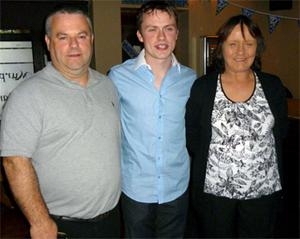 James at his recent 21st birthday with parents Jimmy and Essie