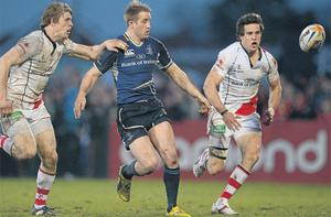 Luke Fitzgerald finds himself outnumbered by Andrew Trimble and Adam D'Arcy as he battles to win possession.