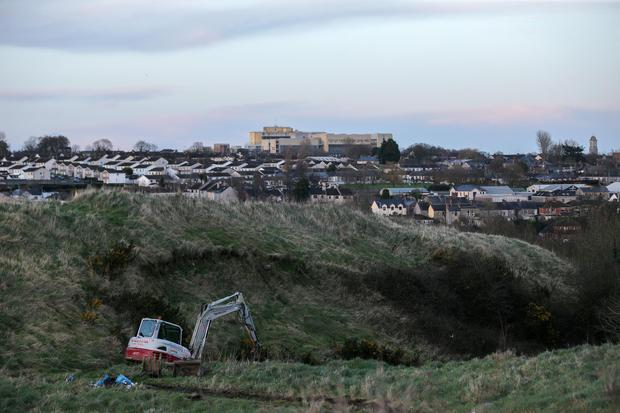 An earthmover moves in to the site next to Rathmullen Park in Drogheda where partial body parts were discovered. (Picture: David Conachy)