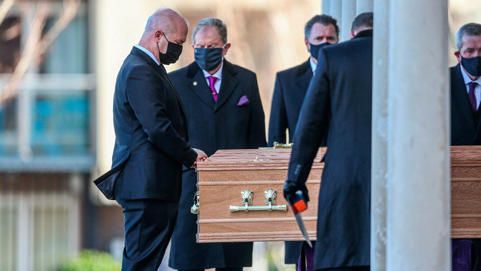 Ireland's chief medical officer Dr Tony Holohan (left) prays by the casket of his wife, as it arrives for her funeral mass at St Pius X Church, Terenure, Dublin. Picture date: Monday February 22, 2021. PA Photo. Dr Emer Feely had been living with a terminal form of blood cancer since 2012. Photo credit should read: Damien Storan/PA Wire