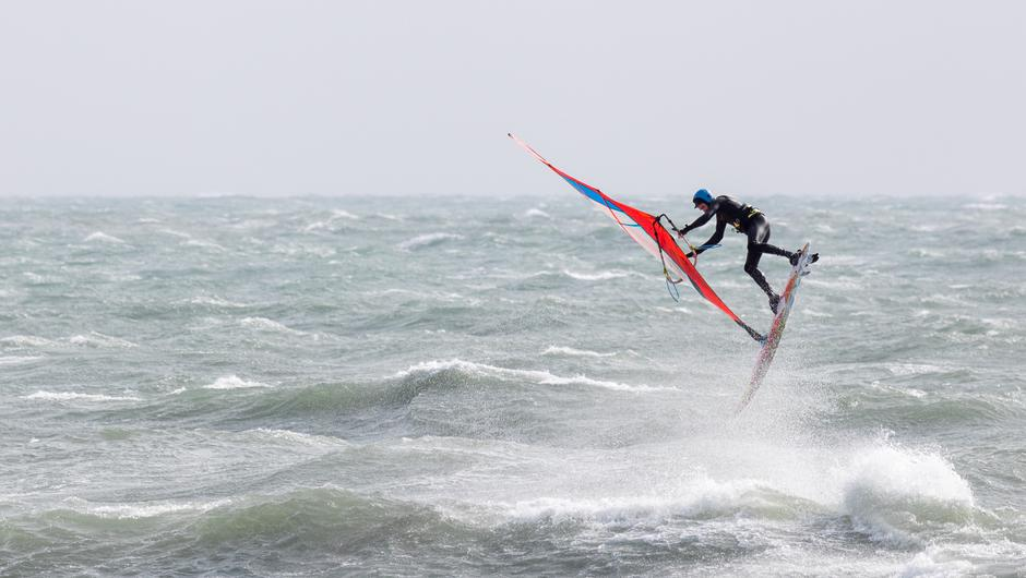 Garrettstown, Cork, Ireland. 26th March, 2021. A Windsurfer taking advantage of the stormy conditions at Garrettstown, Co. Cork, Ireland. - Picture; David Creedon / Anzenberger