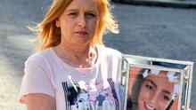 Jackie Fox holds a photo of her daughter Nicole