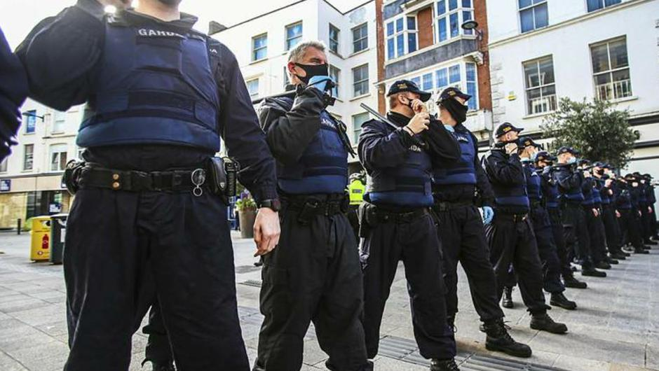 Garda Public order personnel form a line on Grafton Street after disorder erupted at a planned anti lockdown gathering in Dublin City centre.