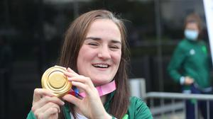 Irish boxing Olympic hero Kellie Harrington shows off her gold medal at Dublin Airport. Picture: Collins