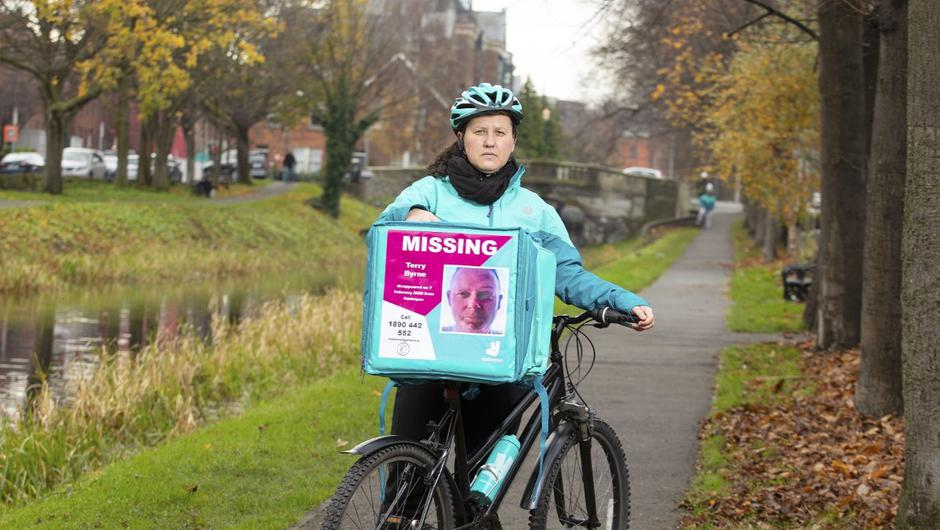A Deliveroo rider with a food delivery bag showing a picture of Gerard Taylor from Dundrum who disappeared from his home on 25 May 2019