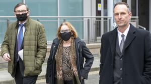 Padraig Creaven (right), of Menlo, Galway, widower of Aoife Mitchell Creaven, leaving the High Court with Aoife's parents, Gabriel (left) and Marcella Mitchell. Photo: Collins Courts