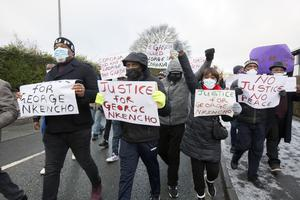 People protest against the shooting of George Nkencho outside Blanchardstown Garda station this morning. Photo: Tony Gavin