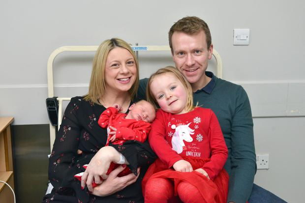 Happy families: John and Gill Redmond from Dublin and their daughter Cara (4) cuddle new arrival Noah. Photo: Barbara Lindberg