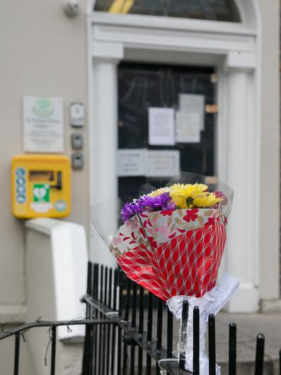 Floral tributes outside the Inner City Helping                   Homeless offices on Amien Street. Picture by Gareth                   Chaney