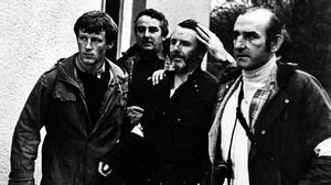 Don Tidey (centre) with gardaí following his rescue. Photo: Irish Times
