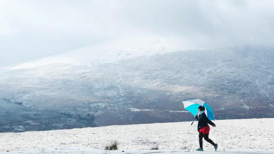 A walker enjoys the snow in the mountains near Killakee, to the south east of Dublin Photo credit: Niall Carson/PA Wire