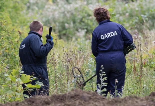 Police searching the site. Picture: Fergal Phillips