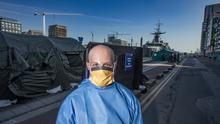 A Naval staff member at the test centre for Covid-19 on Sir John Rogerson's Quay, Dublin, last March. Photo: Mark Condren