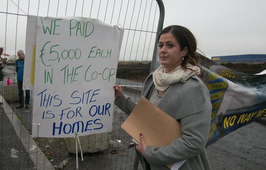 Deirdre Taylor protesting outside the Poppintree site on behalf of co-op members who have invested large sums of money for planning permission for 40 houses on the site