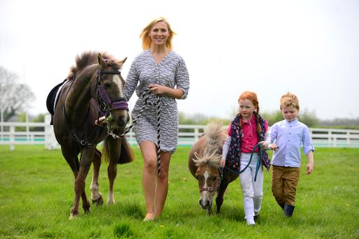 Model Sarah McGovern Vaughan and Kasey Lou Carberry (6) with Jude Vaughan (4) at the announcement of details of the Tattersalls International Horse Trials. Photo: Pat Healy