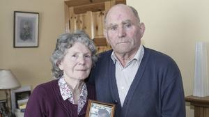 Mary and Denis Snr Walsh from Caherdavin, Limerick, hold a photo of their son Denis who at the age of 23 went missing in 1996. Photo: Liam Burke