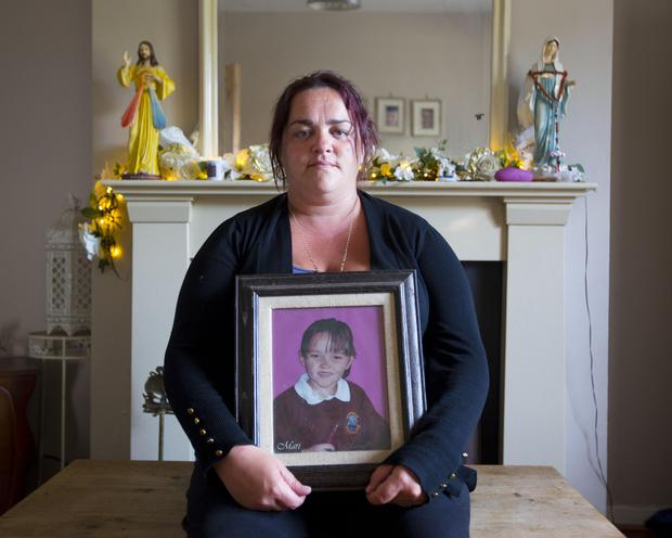 Teresa Keane pictured in her home in Boyle County Roscommon with a picture of her daughter, Mari, who died in an arson attack on their home in 2011. Photo: Brian Farrell