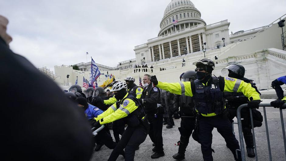 Police clash with Trump supporters at Capitol Hill. Photo: PA.