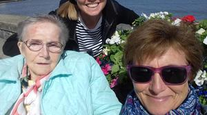 Valerie Anderson (80), a resident of Dealgan Nursing Home, with daughters Carolyn (behind) and Jane (right) in Blackrock, Co Louth. Valerie died on April 10, 2020