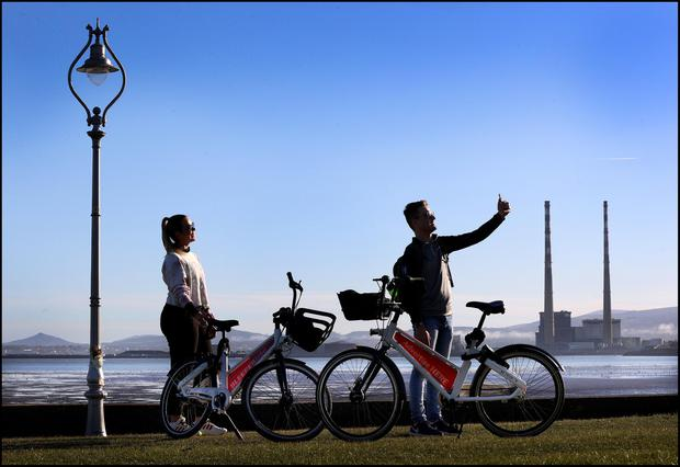 Dafne Schilling Bernardes and Adriano Buchling from Clontarf take a selfie along the coast at Dollymount during sunny weather in Dublin. February 28, 2021 Photo by Steve Humphreys